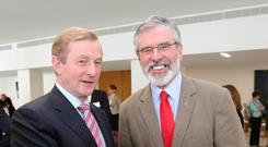 NO CERTAINTY: Taoiseach Enda Kenny and Sinn Fein leader Gerry Adams