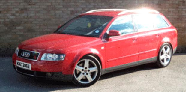 Photo of a car identical to a dark red Audi A4 estate, with the registration number KNZ 2862 and which detectives believe was used by attackers to flee the scene