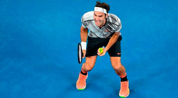 Roger Federer celebrates his victory over Rafa Nadal in the men's final of the Australian Open. Photo by Quinn Rooney/Getty Images
