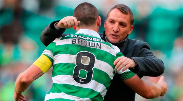 Celtic manager Brendan Rodgers and his captain Scott Brown embrace after the team's comprehensive victory over Hearts at Celtic Park yesterday.