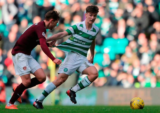 Hearts Sam Nicholson (left) and Celtic's Kieran Tiernay in action. Photo credit: Andrew Milligan/PA Wire