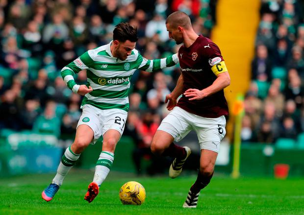 Celtic's Patrick Roberts (left) and Hearts Perry Kitchen battle for the ball. Photo credit: Andrew Milligan/PA Wire