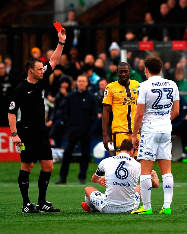 Referee Stuart Attwell gives a red card too Liam Cooper of Leeds United. Photo by Mike Hewitt/Getty Images