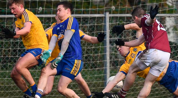 Danny Cummins shoots through a forest of Roscommon arms and legs to score Galway's second goal in the Connacht FBD League final at Kiltoom yesterday. Photo: Sportsfile