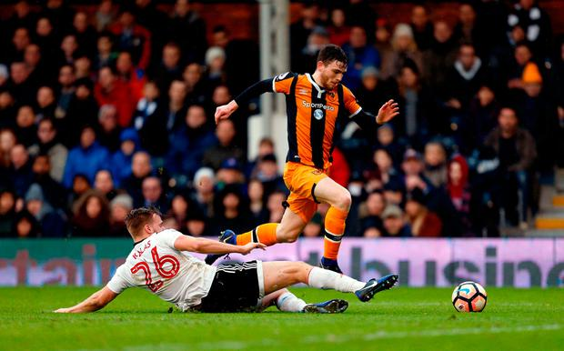 Hull City's Andrew Robertson (right) and Fulham's Tomas Kalas battle for the ball. Photo credit: Paul Harding/PA Wire