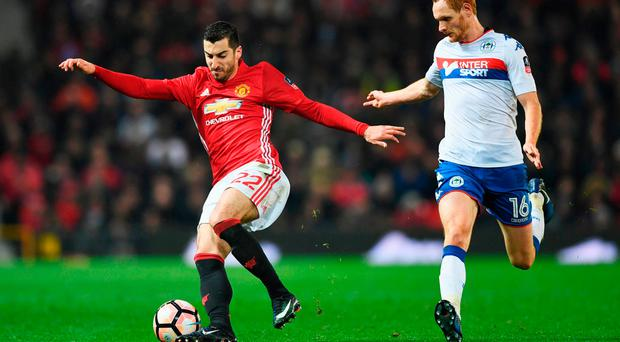 Henrikh Mkhitaryan of Manchester United evades Shaun MacDonald of Wigan Athletic. Photo by Gareth Copley/Getty Images