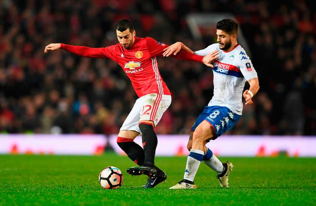 Henrikh Mkhitaryan of Manchester United holds off Sam Morsy of Wigan Athletic. Photo by Gareth Copley/Getty Images