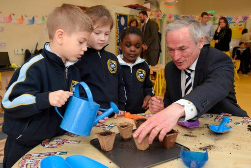 Education Minister Richard Bruton gets his hands dirty during a science lesson with first-class pupils. Photo: Maura Hickey