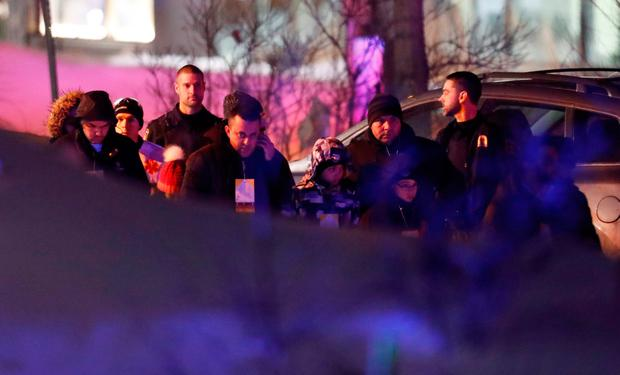 People are seen near a mosque after a shooting in Quebec City, January 29, 2017. REUTERS/Mathieu Belanger