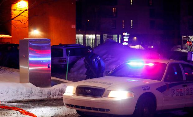 A police officer patrols the perimeter near a mosque after a shooting in Quebec City, January 29, 2017. REUTERS/Mathieu Belanger