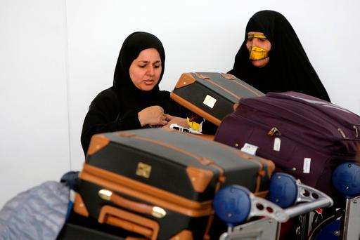 Women check their luggage after arriving on a flight from Dubai on Emirates Flight 203 at John F. Kennedy International Airport in Queens, New York, U.S., January 28, 2017. REUTERS/Andrew Kelly