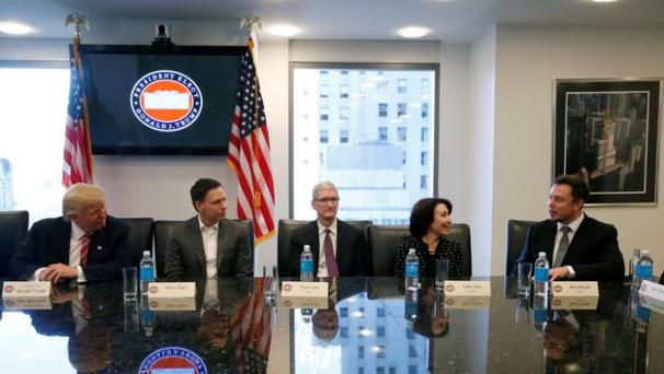 U.S. President-elect Donald Trump sits with PayPal co-founder and Facebook board member Peter Thiel, Apple ceo Tim Cook, Oracle ceo Safra Catz and Tesla chief executive Elon Musk during a meeting with technology leaders at Trump Tower in New York U.S., December 14, 2016. REUTERS/Shannon Stapleton - RTX2V2DE