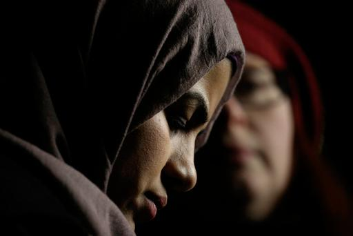 A young Muslim woman listens during a protest held in response to President Donald Trump's travel ban, in Seattle, Washington, U.S. January 29, 2017. REUTERS/David Ryder