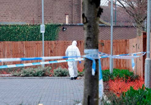 Police forensic officers at the scene after a woman's body was found in a car outside a Lidl supermarket in the Tile Cross area of Birmingham shortly before 5am on Monday. Matthew Cooper/PA Wire