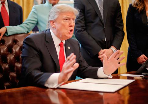 President Donald Trump speaks in the Oval Office of the White House in Washington, before signing an executive order. Photo: AP Photo/Pablo Martinez Monsivais