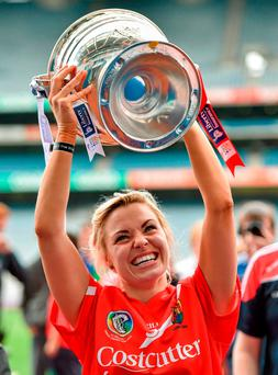 The example set by high-profile female athletes like camogie player Anna Geary, is not enough to inspire schoolgirls to keep up their participation in sports and fitness. Photo: Paul Mohan / SPORTSFILE