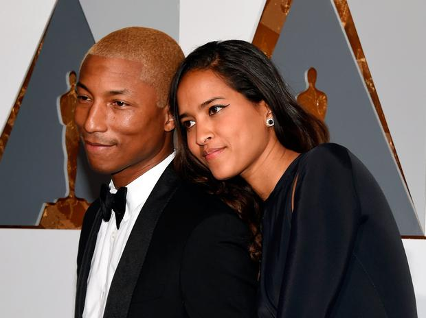 f14b983d3 Pharrell Williams (L) and Helen Lasichanh attend the 88th Annual Academy  Awards at Hollywood
