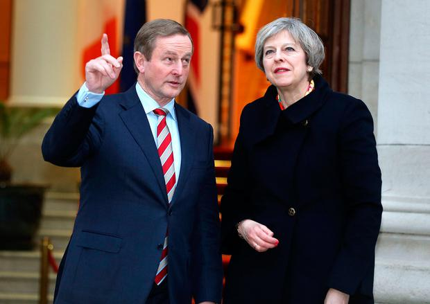 Taoiseach Enda Kenny, pictured with British Prime Minister Theresa May, hopes the plan will mitigate the effects of Brexit. Photo: Gerry Mooney