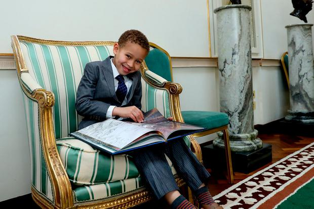 Dusan Matulay (6), the son of the Slovakian Ambassador, takes a time out during reception in the Francini Corridor in Aras An Uachtarain. Photo: Maxwells