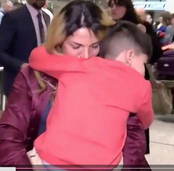A boy detained at Dulles International airport in Washington DC was reunited with his mother