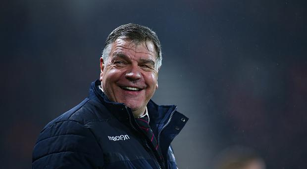 January 31st 2017, Vitality Stadium, Bournemouth, Dorset, England; EPL Premier league football, Bournemouth versus Crystal Palace; Crystal Palace Manager Sam Allardyce shares a joke with a Bournemouth fan during the second half (Photo by Mark Kerton/Action Plus via Getty Images)