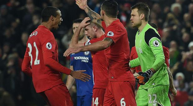 Liverpool's German-born Cameroonian defender Joel Matip (L) reacts after Liverpool's Belgian goalkeeper Simon Mignolet (R) saved a penalty by Chelsea's Brazilian-born Spanish striker Diego Costa (unseen) during the English Premier League football match between Liverpool and Chelsea at Anfield in Liverpool, north west England on January 31, 2017.