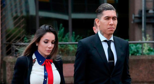 Footballer Roberto Firmino leaving Liverpool City Magistrates Court where he is charged with drink driving, after he was stopped by police in Liverpool city centre in the early hours of Saturday, December 24. Peter Byrne/PA Wire
