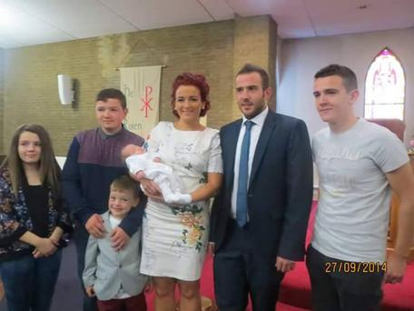 Kiera, centre, pictured with her siblings Caoimhe (15) and Colm (19), left, son Riley (8), partner John. centre right, and brother Kieran, right, at Conor's christening.