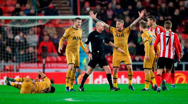 Tottenham Hotspur players appeal to referee Lee Mason after Sunderland's Jack Rodwell (second right) tackled Tottenham Hotspur's Mousa Dembele (floor) during the Premier League match at the Stadium of Light last night