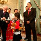 President Higgins signs a book for 8 year old Saylor Burke at a reception in Aras an Uachtarain for representatives of the Peruvian community in Ireland to celebrate the 195th anniversary of the Independence of Peru. Picture; Gerry Mooney