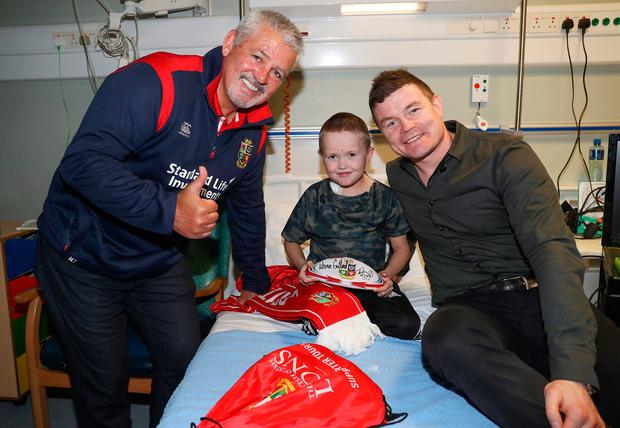 Lions coach Warren Gatland and Brian O'Driscoll with Aidan O'Brien, age 9 from Mallow, at Temple Street yesterday. The Lions have partnered with the Dublin hospital for 2017 and O'Driscoll and Gatland will be guests of honour at a fund-raising dinner at the Mansion House on March 3. Photo: ©INPHO/Dan Sheridan