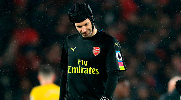 A frustrated Petr Cech leaves the pitch after Arsenal suffered a shock 2-1 home defeat against Watford. Photo: PA