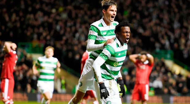 Celtic's Dedryck Boyata celebrates with teammate Mikael Lustig after scoring his side's winner. Photo: PA