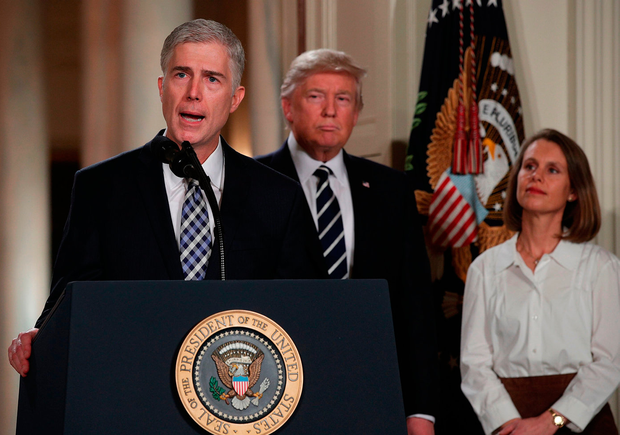 Judge Neil Gorsuch, left, speaks as his wife Louise looks on after US President Donald Trump nominated him to the Supreme Court during a ceremony at the White House Photo: Alex Wong/Getty Images