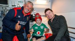 Warren Gatland and Brian O'Driscoll at Temple Street with, from clockwise top left, Luke Herlihy Photo: INPHO/Dan Sheridan