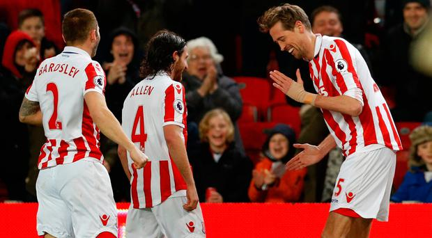 Peter Crouch performs his 'Robot' celebration after scoring against Everton. Photo: Reuters