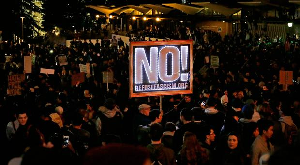 Protestors against a scheduled speaking appearance by polarizing Breitbart News editor Milo Yiannopoulos fill Sproul Plaza on the University of California at Berkeley campus on Wednesday, Feb. 1, 2017, in Berkeley, Calif. . (AP Photo/Ben Margot)