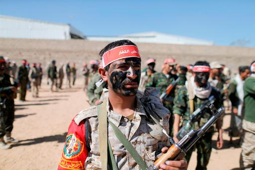 Newly recruited Houthi fighters take part in a parade before heading to the battle front to fight against government forces in Sanaa, Yemen, February 1, 2017. The headband reads: