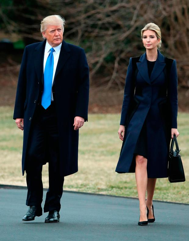 U.S. President Donald Trump and his daughter Ivanka Trump walk toward Marine One while departing from the White House, on February 1, 2017 in Washington, DC. Trump is making an unannounced trip to Dover Air Force base in Delaware to pay his respects to Chief Special Warfare Operator William