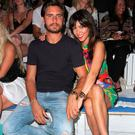 TV personalities Scott Disick and Kourtney Kardashian attend the Wildfox Swim Cruise 2014 show at Soho Beach House on July 21, 2013 in Miami Beach, Florida. (Photo by John Parra/Getty Images for Wildfox)