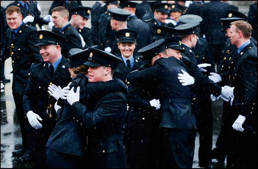 Gardaí celebrate after the passing out ceremony of probationer gardaí at the Garda College in Templemore yesterday. Photo: Steve Humphreys