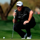 Shane Lowry sizes up a putt on the ninth green at the Waste Management Phoenix Open in Scottsdale, Arizona. Photo: Christian Petersen/Getty Images