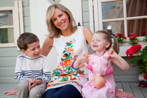 Laura Erskine, with her children John and Lucy, is opposed to the new legislation which she says has put parents in a 'very difficult situation'. Photo: Alex Oliveira