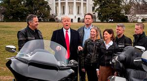 US President Donald Trump talks with Harley Davidson executives on the South Lawn of the White House in Washington DC. Photo: Drew Angerer/Getty Images