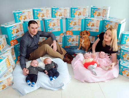 Quadruplets Max, Alex, Ashley and Kayla Downey, with parents Wayne Downey and Lisa Fenton, and family dog Cody, Ros Mor. Photo: Gareth Williams