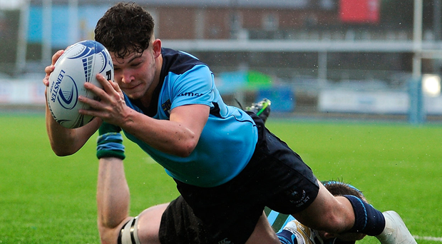 Stephen Judge of St Michael's College goes over to score his sides second try during the match against St Gerards School. Photo: Sam Barnes/Sportsfile