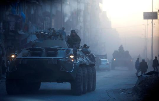 Russian soldiers, on armoured vehicles, patrol a street in Aleppo, Syria February 2, 2017. REUTERS/Omar Sanadiki