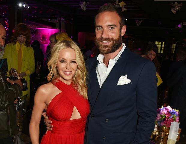 Kylie Minogue (L) and Joshua Sasse attend the World Premiere after party of