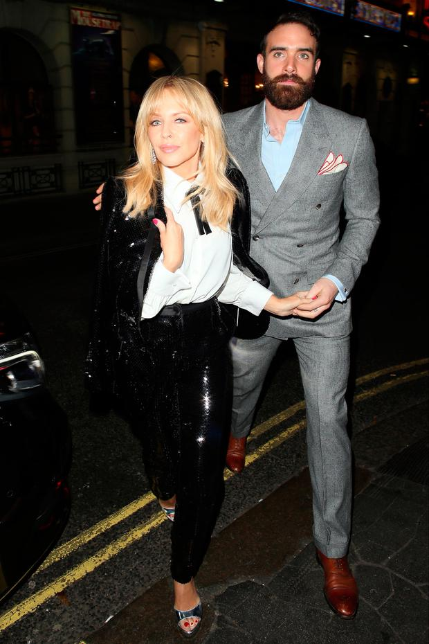 Kylie Minogue and Joshua Sasse at the Ivy restaurant for her intimate performance on December 7, 2016 in London, England. (Photo by Mark Milan/GC Images)