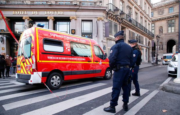 A rescue workers van makes its way in th restricted area outside the Louvre museum in Paris,Friday, Feb. 3, 2017. Paris police say a soldier has opened fire outside the Louvre Museum after he was attacked by someone, and the area is being evacuated. (AP Photo/Thibault Camus)